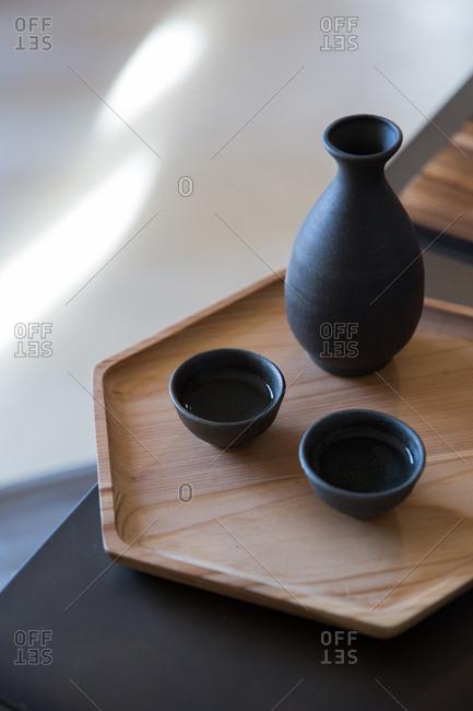 Ceramic sake set on wooden serving tray