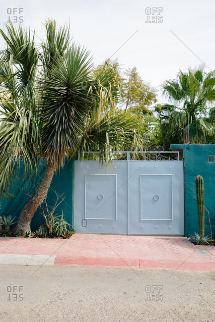 Closed gate along wall in Todos Santos, Mexico