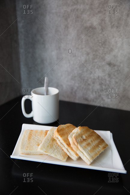 Kaya toast served with a cup of coffee