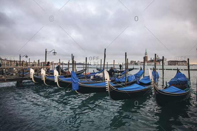 Venice, Italy - November 9, 2010: Gondolas moored in the San Marco basin with the church of San Giorgio Maggiore in the background