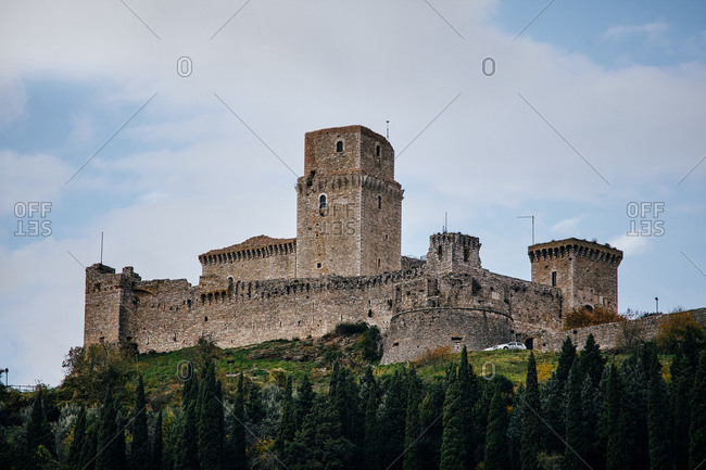 Looking up at the fortress of Rocca Maggiore which overlooks the town of Assisi, Italy
