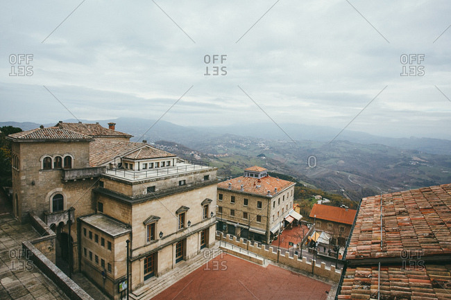 San Marino - November 17, 2010: Looking down over the tiled rooftops and into the valley beyond