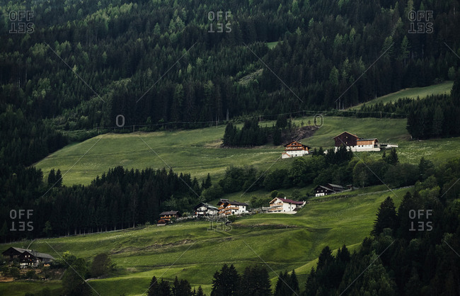 A small Tyrolean settlement on the side of a steep hill in Ainet, Austria