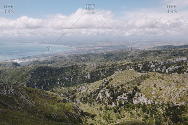 Looking towards the Adriatic over the craggy landscape of Monte Sant'Angelo, Apulia, Italy