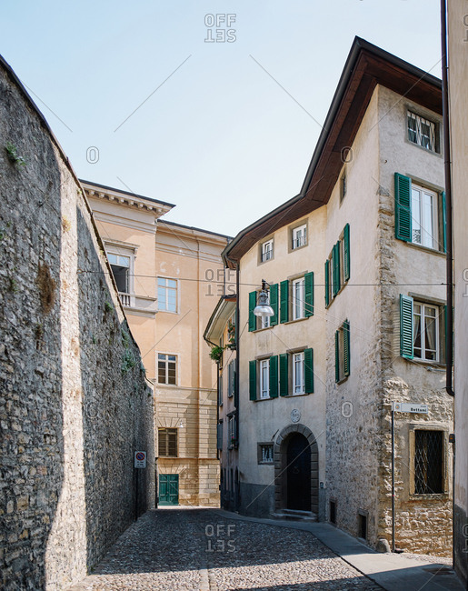 A densely packed narrow cobbled street in Bergamo, Italy