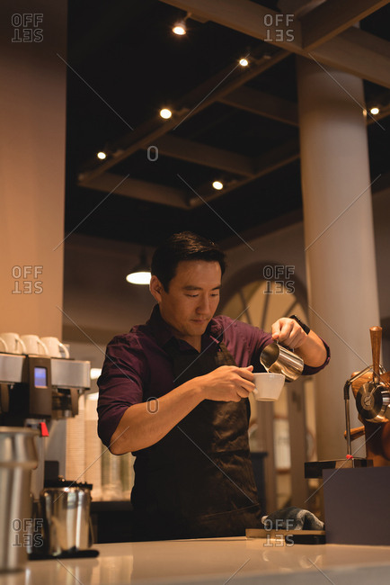 Smart waiter preparing coffee in coffee shop