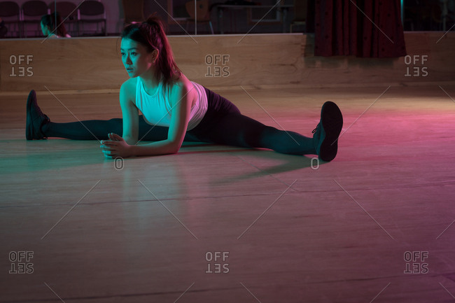 Young female dancer exercising in dance studio