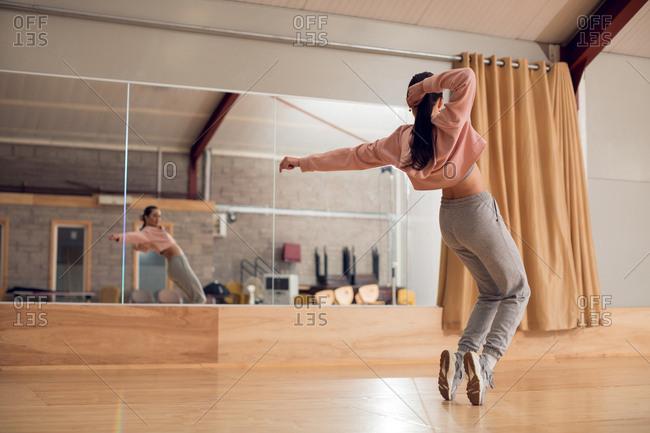 Young female dancer dancing in dance studio