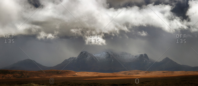 Panoramic view of stormy sky approaching the mountain of Ben Loyal in Sutherland, Scotland