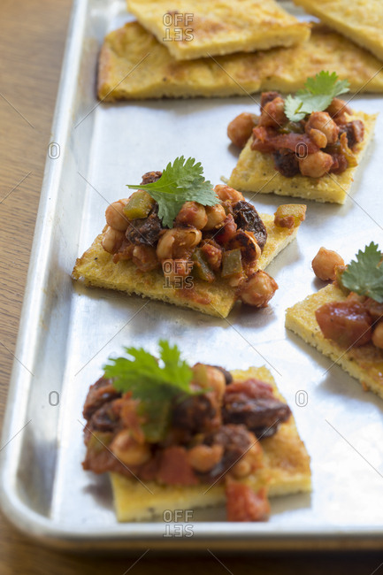 Savory appetizer squares on cooking tray