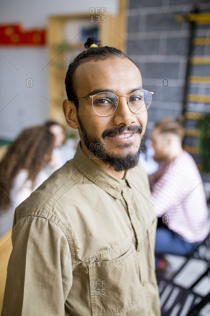 Three quarter profile of young south Asian man in co-working space