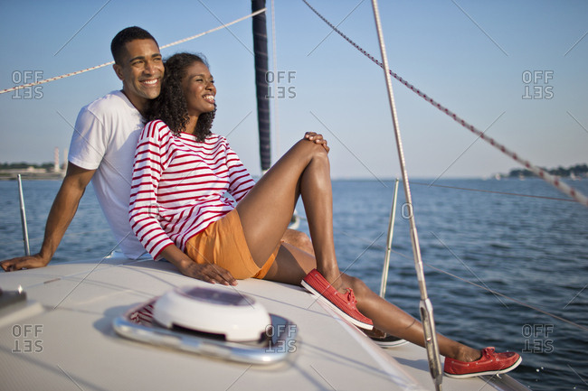 Happy young couple relaxing and having fun while sailing