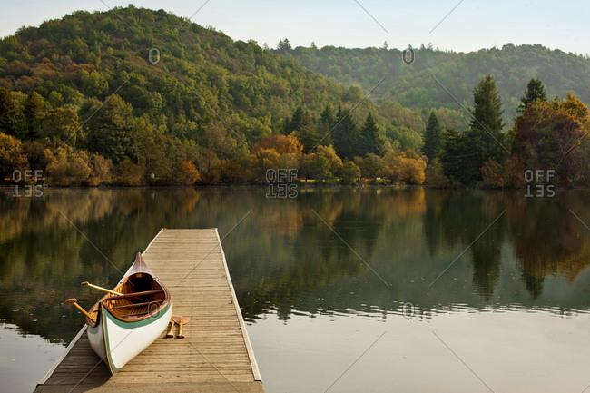 Canoe on a lake pier in autumn