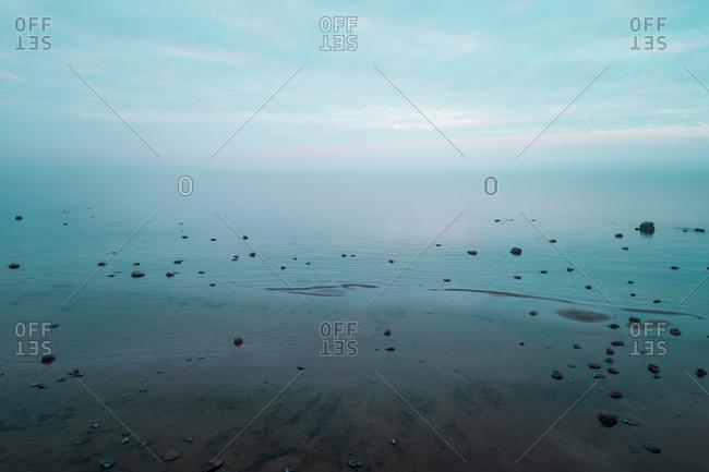 Aerial view of beautiful sea and horizon from beach in Muraste village, Estonia