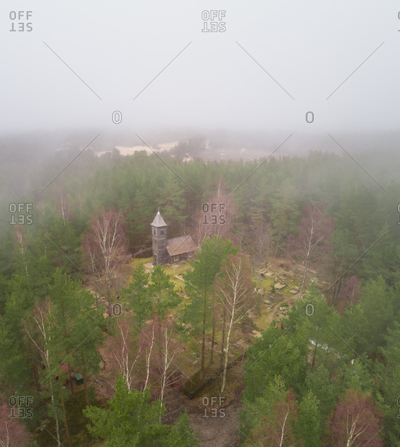 Aerial view of Prophet Elijah Orthodox Chapel surrounded by forest in Malvaste, Estonia