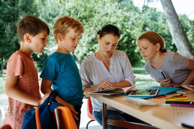 Schoolchildren engaged in listening to a teacher