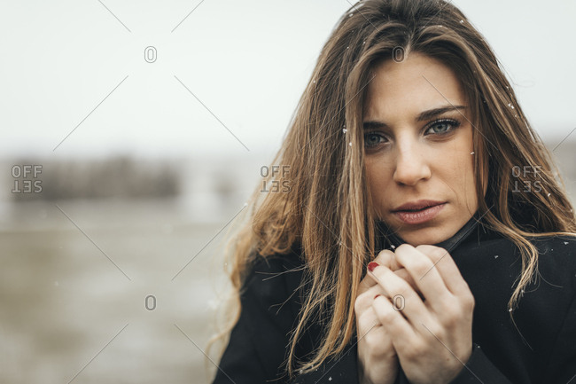 Outdoor headshot of female model wearing winter jacket outside