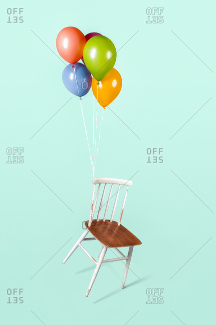 Balloons tied to an old chair