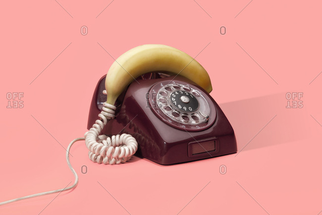 Vintage rotary dial telephone with a banana for a handset