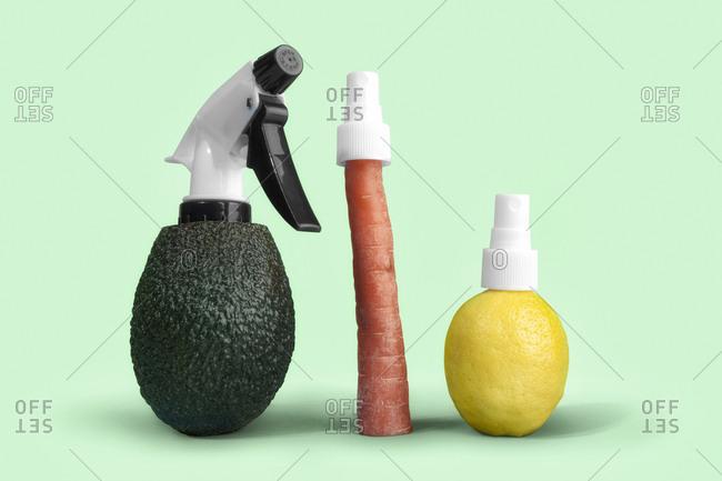 Avocado, carrot, and lemon with spray tops