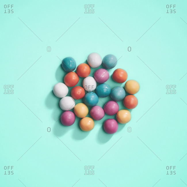 Colorful candies arranged on blue background