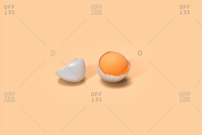 Egg yolk in broken eggshell
