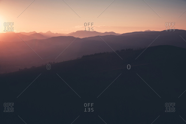 Scenic view of mountain range at sunset