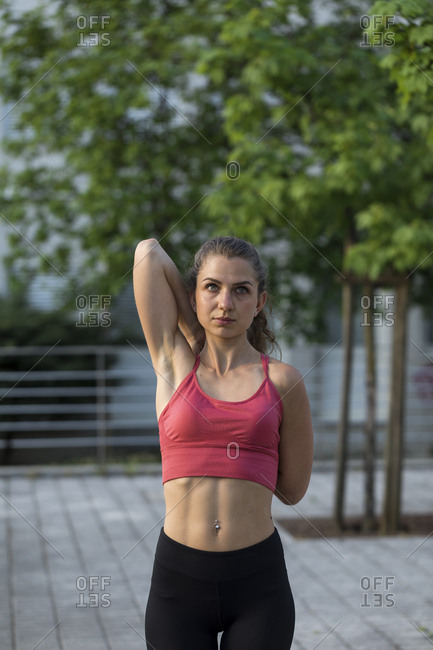 Young woman stretching outdoors