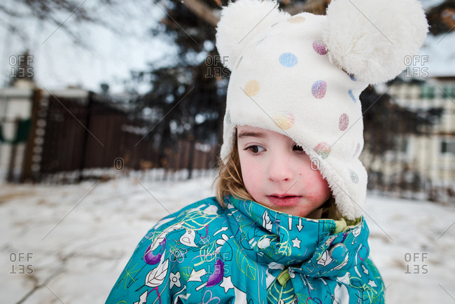 Portrait of cold little girl standing outside