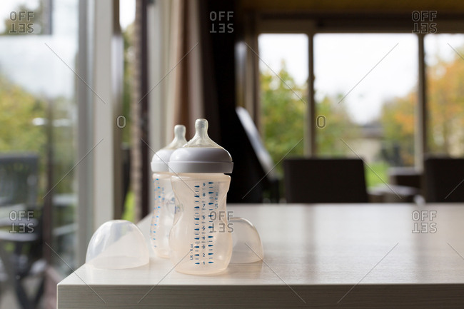 Empty baby bottles on living room table