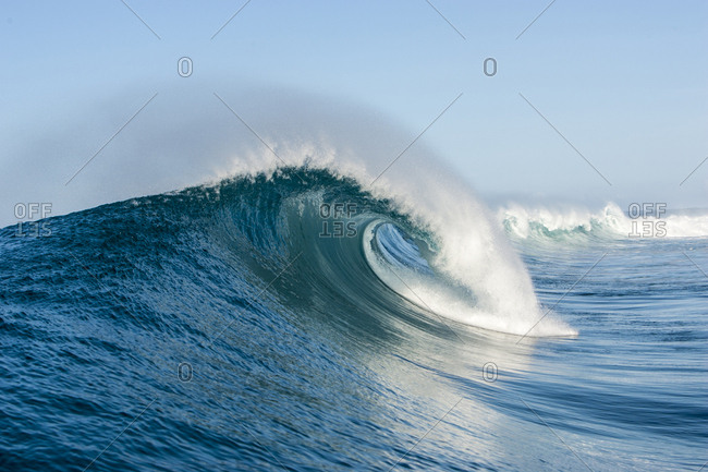 Ocean wave in motion on sunny day