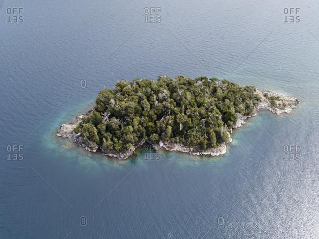 Aerial view of small wooded Nahuel Huapi Lake island