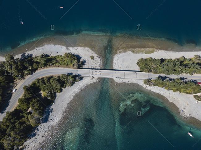 Drone view of bridge on sunny Moreno lake