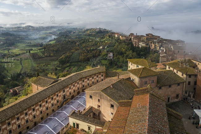 Foggy morning in San Miniato village, Tuscany, Italy
