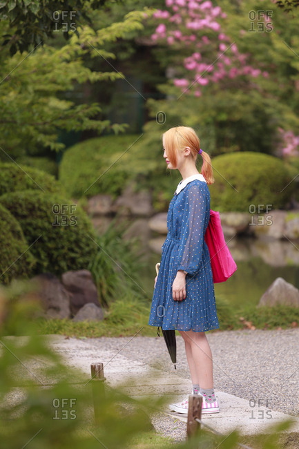 July 15, 2013: Young girl in the famous To-ji temple gardens, in Minami-ku. Unesco World Heritage Site, Kyoto, Japan