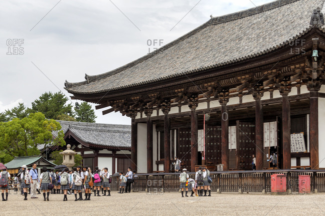 July 16, 2013: Students in front of the Kofukuji Temple, designated Unesco World Heritage, Nara, Japan