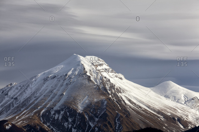 A clearing snowstorm reveal the peaks of the Gran Sasso mountain range, Gran Sasso and monti della Laga national park, Abruzzo, Italy