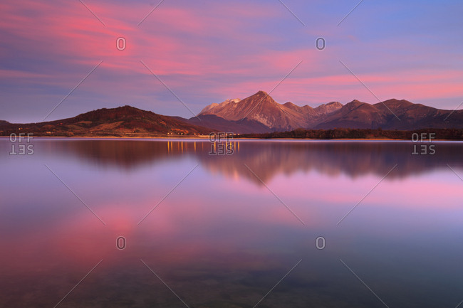 The lake of Campotosto at sunset, Gran Sasso e Monti della Laga national park, Abruzzo, Italy