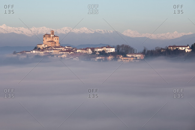 The church of Treville, one of the highest place in Monferrato, in the fog. On the background the Alps, Monferrato, Piedmont, Italy, Europe