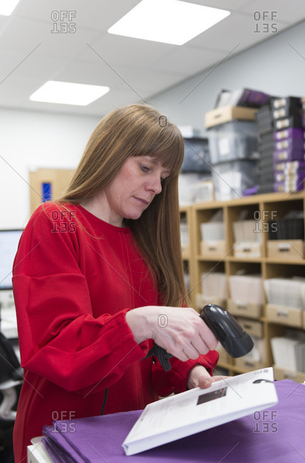 A female small business owner in her office stock room