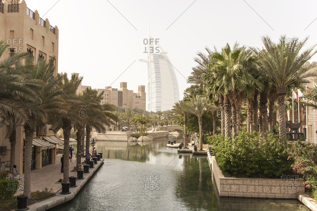 Dubai, United Arab Emirates - May 13, 2012: A view of the landscaped Madinat Jumeirah hotel with the Burj Al Arab hotel rising in the background