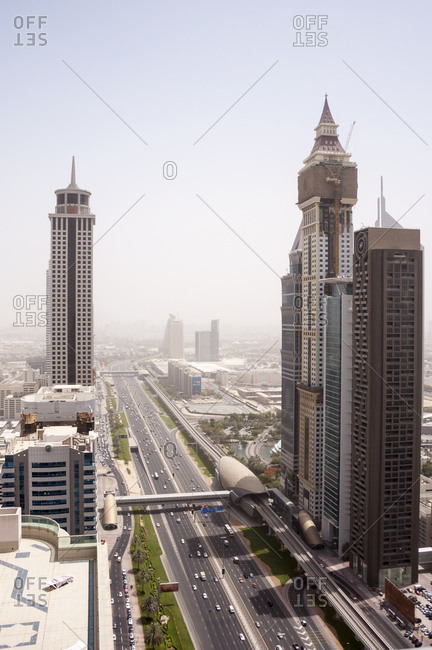 Dubai, United Arab Emirates - May 14, 2012: Multi lane highway cutting through towers of downtown