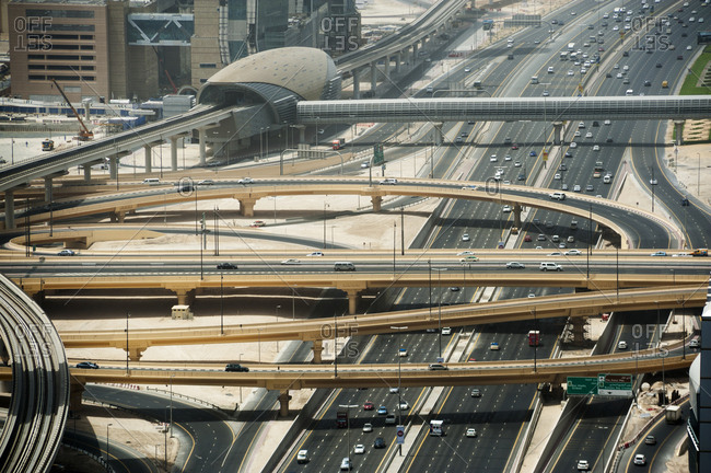 Dubai, United Arab Emirates - May 14, 2012: An elevated view of roads and metro line crossing Sheikh Zayed Road