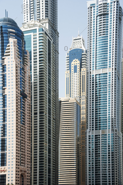Dubai, United Arab Emirates - May 14, 2012: Futuristic skyscrapers crowd skyline to form geometric patterns