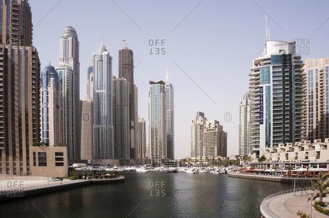 Dubai, United Arab Emirates - May 14, 2012: Modern skyscrapers crowd the waterfront at Dubai Marina