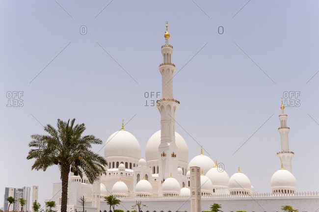 The minarets and domes of the Sheikh Zayed Grand Mosque in the shimmering heat of Abu Dhabi, United Arab Emirates
