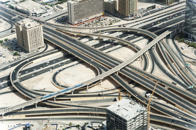 Dubai, United Arab Emirates - May 17, 2012: An aerial view of multitude of roads and metro line intertwining