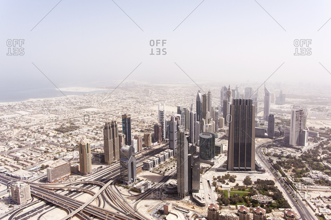 Dubai, United Arab Emirates - May 17, 2012: An aerial view of cluster of skyscrapers and landscape disappearing into desert haze