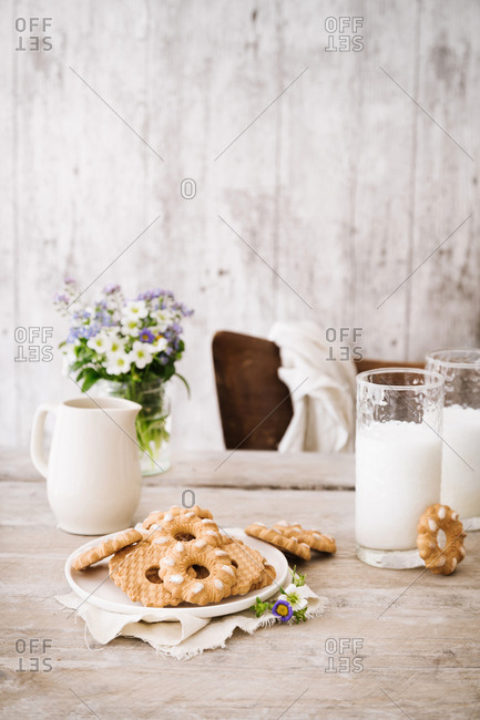 Cookies and milk on wooden table