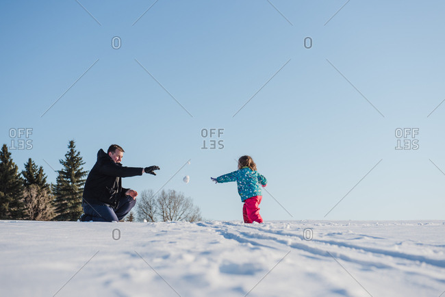 Father and daughter playing outside on a snow day